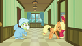 Applejack pushes Big McIntosh into the room S6E23.png