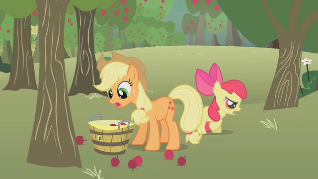 File:Applejack picking up apples S1E12.png