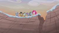 Pie family looking over the cliff S5E20
