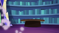 Library books and table swiftly organized S6E21.png
