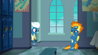Spitfire leaning by the locker room entrance S6E7