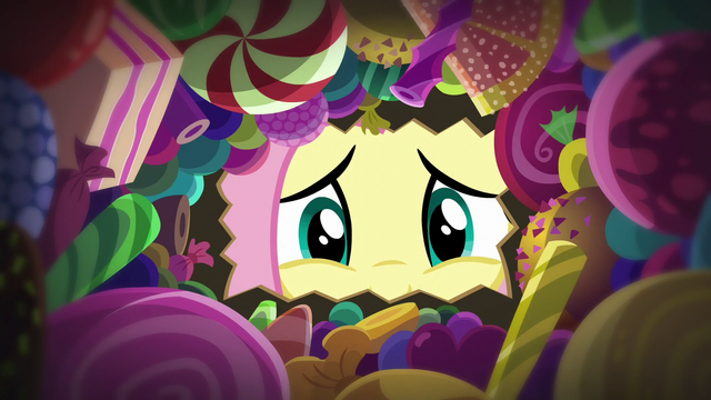 File:Fluttershy looks inside her candy bag S5E21.png