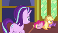 Pinkie Pie falls over on top of Applejack S7E14.png