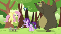 Starlight looking at the critters; bear about to hug her S5E26