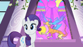 Discord on a stained glass window next to Rarity S2E1.png