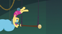 Trapeze star flipping around the trapeze bar S6E20