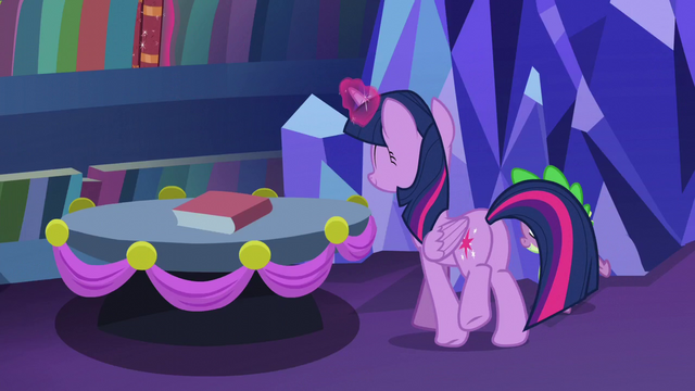 File:Twilight places the book back to the shelves S06E08.png