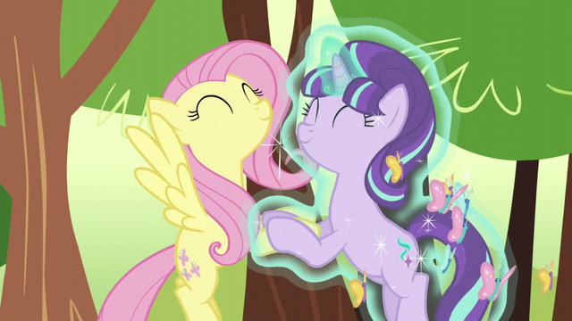 File:Fluttershy and Starlight holding each other's hooves S5E26.png