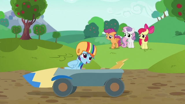 File:Rainbow Dash coasts past screen in speed cart S6E14.png