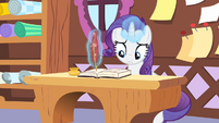 Rarity writing on the journal S4E08