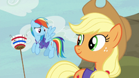 Rainbow and Applejack looking pleased S6E18