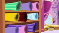 Rolls of fabric at Carousel Boutique S6E6.png