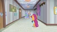 Scootaloo follows Bow and Windy down another hallway S7E7