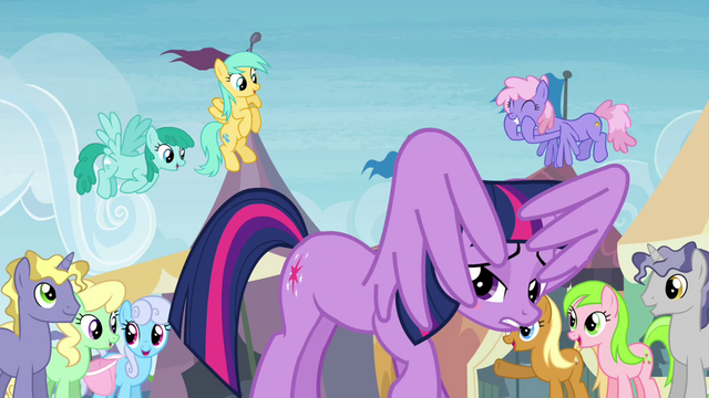 File:Twilight underneath her own wings at the exchange S4E22.png