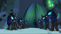 Changeling guards watch the chamber doors close S6E26