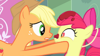 Applejack holding Apple Bloom's face S4E17