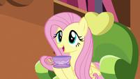Fluttershy holding a teacup S5E7