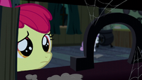 Apple Bloom looking at an upright horseshoe S5E6