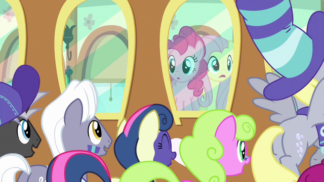 File:Pinkie and Fluttershy looking at their fans S6E18.png