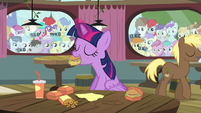 Twilight eating while foals behind windows look at her S4E15