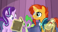 Sunburst gives Starlight the book detailing Somnambula's Weather Abjuration S6E2