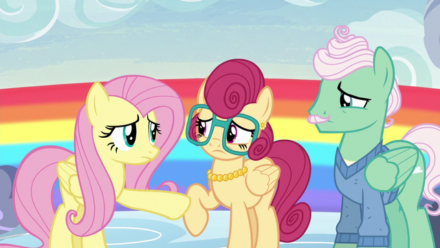 File:Fluttershy holding her mother back S6E11.png