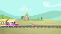 Pinkie Pie running towards the train S4E11