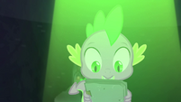 Spike looks at the book S4E23