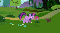 Twilight practicing magic with a flower S3E05