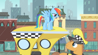 Rainbow Dash on top of a cab S4E08
