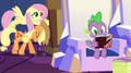 AJ and Fluttershy pushing a box while Spike reads a Daring Do novel EG2.png
