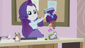 Rarity emptying the contents of her bag EG2.png
