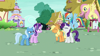 Applejack and Rarity laugh as Rainbow and Fluttershy enter S6E25
