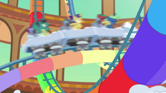 File:Ponies whizzing by the resort roller coaster S6E20.png
