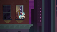 Coco on her balcony at nighttime S5E16