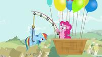Pinkie Pie pulls Rainbow using a fishing rod S4E12