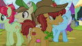 Apple family members at the Traders Exchange S4E22.png
