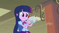 Twilight picking up fruit bowl EG
