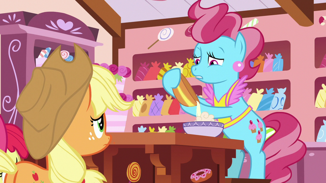 File:Mrs. Cake somberly pouring cake batter S7E13.png