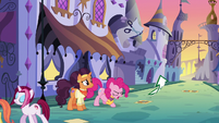 Pinkie hurls arrow sign at the ground; sign curves upward S6E12