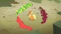 Applejack surrounded by tricolor apples S2E01.png