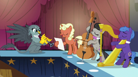Gabby playing clarinet with Octavia's band S6E19