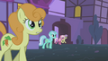 Golden Harvest along with other ponies come out of their homes S1E06.png