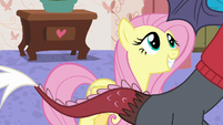 Fluttershy grinning excitedly at Discord S7E12