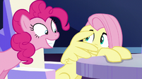 Fluttershy cowers away from Pinkie S6E1