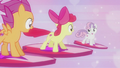 Crusaders flying on shield cutie marks S5E18.png