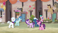 Starlight Glimmer surrounded by laughing villagers S6E25.png