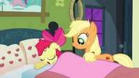 Applejack covering Apple Bloom with a blanket S3E08