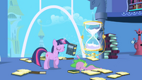 Twilight pulls desired book from Spike's grasp S1E01