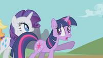 Twilight points to Celestia's chariot S1E10
